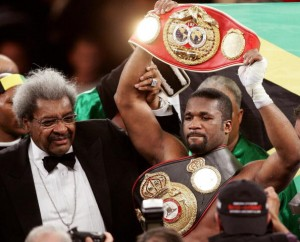 NEW YORK, UNITED STATES:  IBF (International Boxing Federation) champion O'Neil Bell from Jamaica celebrates after knocking out WBA (World Boxing Association) and WBC (World Boxing Council) cruiserweight champion Jean-Marc Mormeck of France in the 10th round during their 12-round cruiserweight championship fight at Madison Square Garden in New York, 07 January 2006. At left is boxing fight promoter Don King.   AFP PHOTO/DON EMMERT  (Photo credit should read DON EMMERT/AFP/Getty Images)
