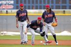 Cleveland Indians second baseman Jason Kipnis, center, gets set to field a ground ball as Michael Martinez, right, and Ronny Rodriguez, left, watch at the team's baseball spring training facility Sunday, Feb. 19, 2017, in Goodyear, Ariz. (AP Photo/Ross D. Franklin)